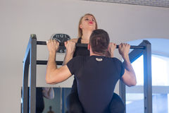 Young Couple Athlete Doing Pull Ups Training Back Together Stock Photos