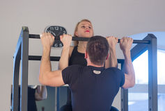 Young Couple Athlete Doing Pull Ups Training Back Together Royalty Free Stock Photography