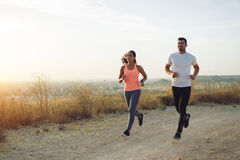 Young couple of athletes running Stock Images