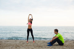 Young couple athletic resting after the workout outdoors Stock Photography