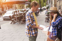 Young couple attractive tourist watching map. Dating and tourism concept. Royalty Free Stock Photo