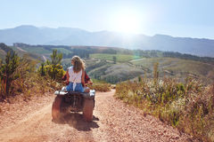 Young couple on an atv Royalty Free Stock Images