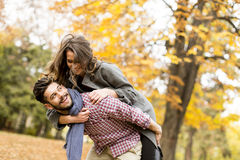 Young couple in the autumn forest Royalty Free Stock Photography