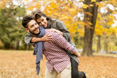 Young couple in the autumn forest Stock Images