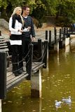 Young couple by autumn lake Royalty Free Stock Images