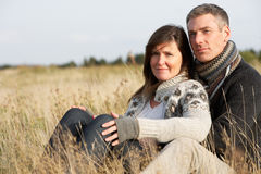 Young Couple In Autumn Landscape stock photography