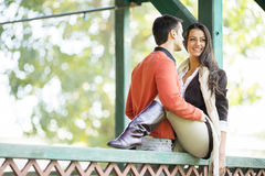 Young couple in the autumn park royalty free stock photography
