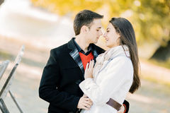 Young couple in the autumn park Royalty Free Stock Photo
