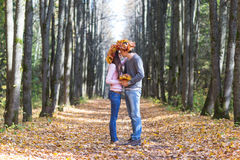Young couple in autumn Park. royalty free stock image