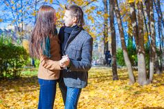 Young couple in autumn park on a sunny fall day Royalty Free Stock Image