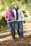 Young couple on autumn walk. Through woods Stock Image