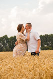 Young couple awaiting baby among the wheat field Royalty Free Stock Photography