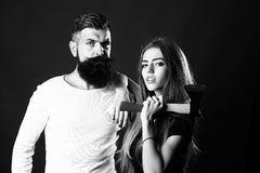 Young couple with axe Royalty Free Stock Image