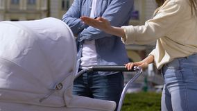 Young couple with baby carriage arguing, bad relationship in family, problems stock video