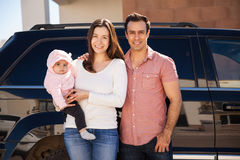 Young couple and baby riding a car Stock Photography