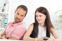 Young couple  back to back. Young couple sitting back to back Royalty Free Stock Photos