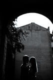 Young couple on background of architecture arch Royalty Free Stock Image