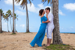 Young couple on the background of palm trees Royalty Free Stock Photos