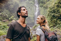Young couple with backpack hiking in nature. Royalty Free Stock Photo