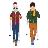 Young couple with backpack and hiking walking sticks Stock Photos