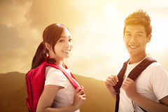 Young  couple with backpacks enjoy hiking Royalty Free Stock Photos