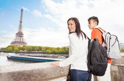 Young couple looking at the Eiffel Tower in Paris Stock Photo