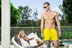 Young couple in backyard Royalty Free Stock Photography