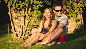 Young couple in the backyard at golden hour Royalty Free Stock Photography