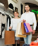 Young couple with bags at fasion store Stock Image