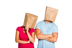 Young couple with bags over heads Stock Images