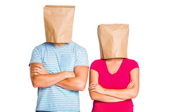 Young couple with bags over heads Stock Photo