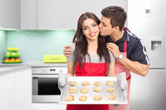 Young couple baking cookies in a kitchen Royalty Free Stock Photo