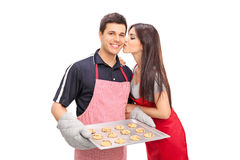 Young couple baking cookies together Royalty Free Stock Photo