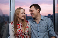 Young couple on the balcony looking to each other Stock Photography