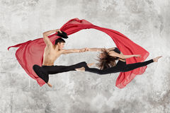 Young couple ballet dancing. On wall background Stock Photography