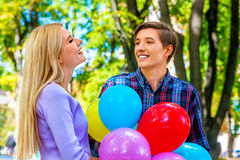 Young couple with ballons in park outdoor stock images