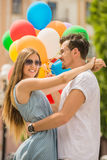 Young couple with balloons Royalty Free Stock Photo