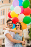 Young couple with balloons Stock Images