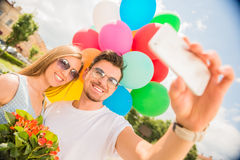 Young couple with balloons Royalty Free Stock Image