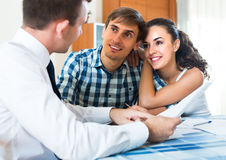 Young couple and banking agent indoors Royalty Free Stock Photo