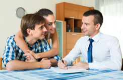 Young couple and banking agent indoors Royalty Free Stock Image