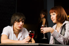 Young couple in a bar. Stock Photos
