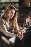 Young couple at the bar Stock Image