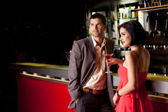 Young couple at bar counter talking. Young couple bar counter having drinks Stock Image