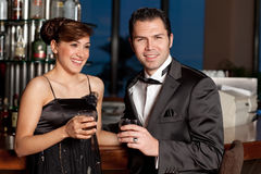 Young couple at bar drinking and flirting Stock Photos