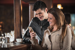 Young couple at the bar Royalty Free Stock Photos