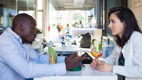 Young couple at the bar. Young people with cocktail at bar Royalty Free Stock Photo