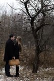 Young couple with basket in fall park Royalty Free Stock Image
