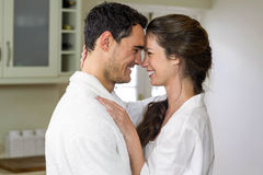 Young couple in bathrobe cuddling each other Royalty Free Stock Image