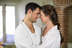 Young couple in bathrobe embracing each other Royalty Free Stock Image